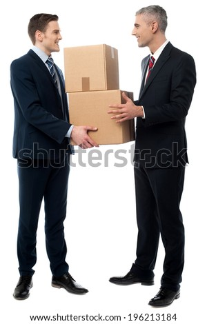 Young businessmen holding cardboard boxes - stock photo