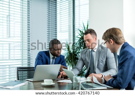 Young businessmen in office - stock photo