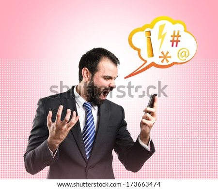 Young businessmen shouting to mobile over pink background.  - stock photo