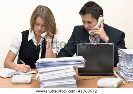 Young businessmen speak on the phone at office. On a white background