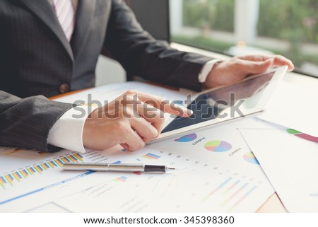 Young businessmen using touchpad at meeting / Focus touchscreen to tablet for present - stock photo