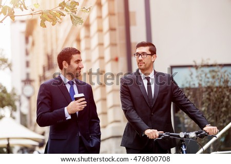 Young businessmen with a bike