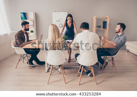 young businesspeople at the conference sitting at the table - stock photo