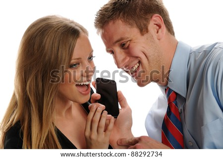 Young businesspeople couple with smart phone having fun isolated on a white background - stock photo