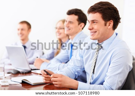 Young businesspeople in office - stock photo