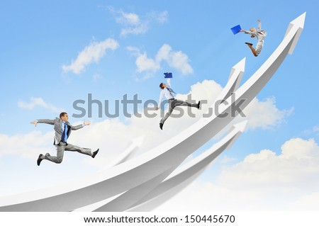 Young businesspeople jumping on white arrows. Growth concept - stock photo