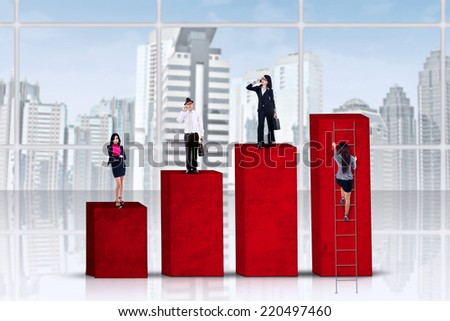 Young businesspeople standing over a business chart - stock photo