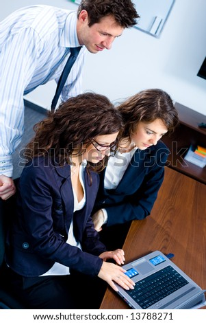 Young businesspeople working together in business team on laptop computer in meeting room at office. - stock photo