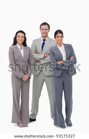 Young businessteam with arms folded against a white background