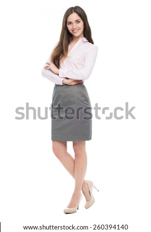 Young businesswoman against white background  - stock photo