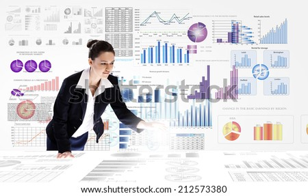 Young businesswoman analyzing data information of market - stock photo