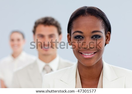 Young businesswoman and her team standing