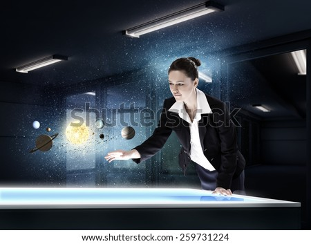 Young businesswoman and planets of space spinning around - stock photo