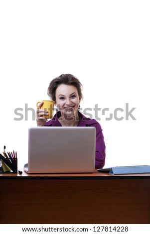 Young businesswoman at an office desk with a cup of coffe isolated on white studio shot