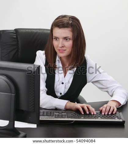 Young businesswoman at her desk working on the computer