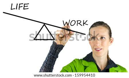 Young businesswoman balancing private life and work. - stock photo