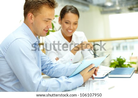 Young businesswoman being pleased with the results of her collaboration - stock photo