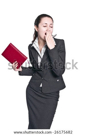 Young businesswoman bored and yawning - stock photo