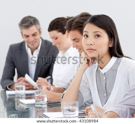 Young businesswoman bored at a presentation with her team - stock photo