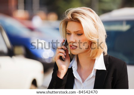 Young businesswoman calling on the mobile phone - stock photo