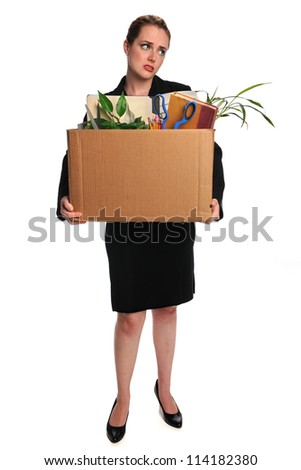 Young businesswoman carrying belongings after loosing employment - stock photo
