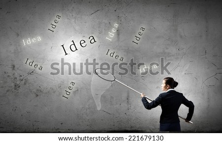 Young businesswoman catching word idea with hoop - stock photo