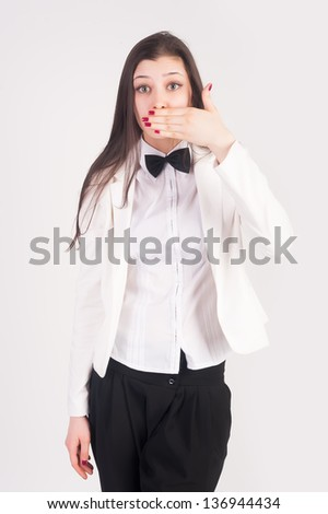 Young businesswoman covering her mouth with her hand - stock photo
