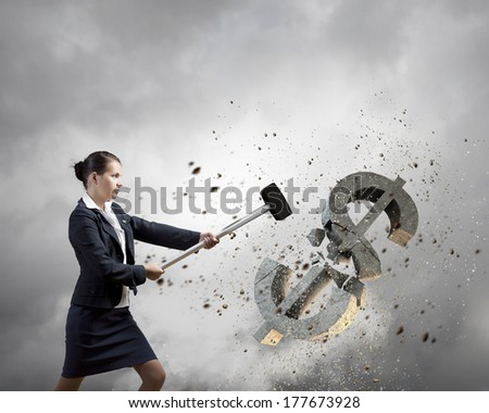 Young businesswoman crashing with hammer stone dollar symbol - stock photo
