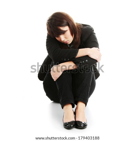 Young businesswoman depression, isolated on white - stock photo