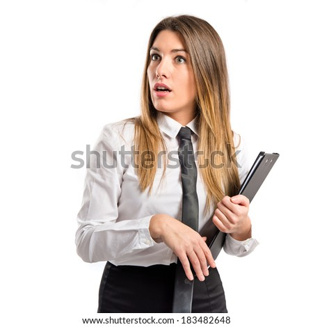 Young businesswoman doing surprise gesture over white background  - stock photo