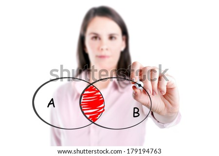 Young businesswoman drawing intersected circle diagram on whiteboard.