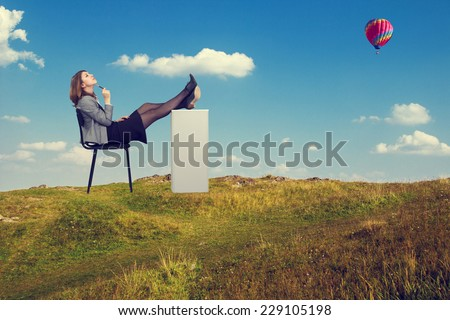 Young businesswoman dreaming sitting on a chair. - stock photo