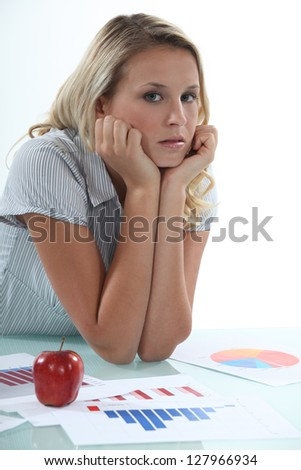 young businesswoman examining the statistics - stock photo