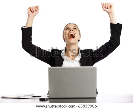 Young Businesswoman excited looking at laptop