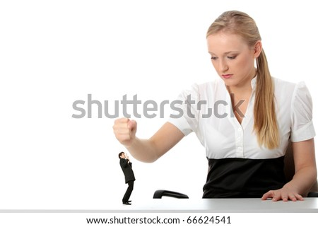 Young businesswoman fighting with small version of businessman. Business sex fight and feminism concept. - stock photo
