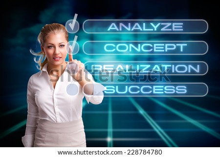 young businesswoman following a checklist - stock photo