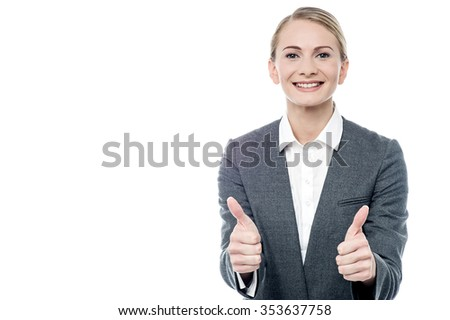 Young businesswoman gesturing success to her colleagues - stock photo