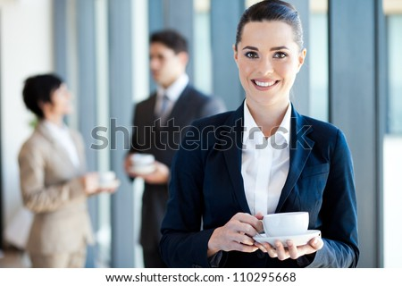 young businesswoman having coffee break at work - stock photo