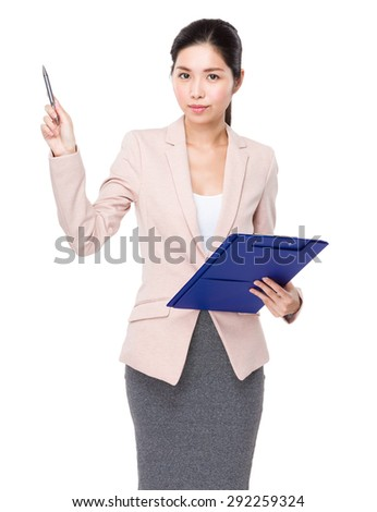 Young Businesswoman hold with clipboard and pen point up