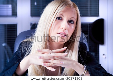 young businesswoman holding a meeting - stock photo
