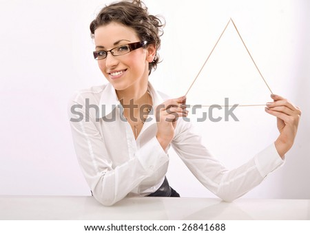 Young businesswoman holding a triangle symbol - stock photo