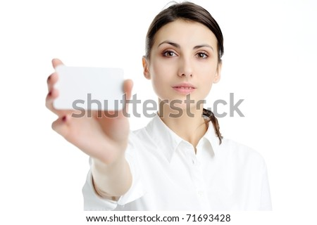 Young businesswoman holding blank businesscard in hand - stock photo