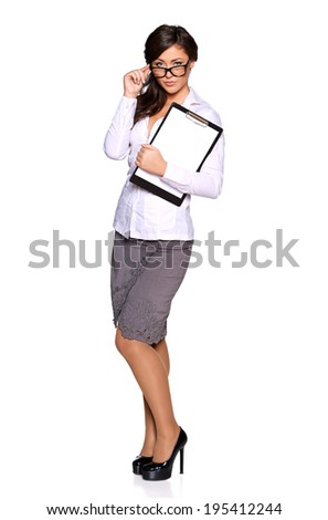 Young businesswoman holding clipboard , isolated on white background - stock photo