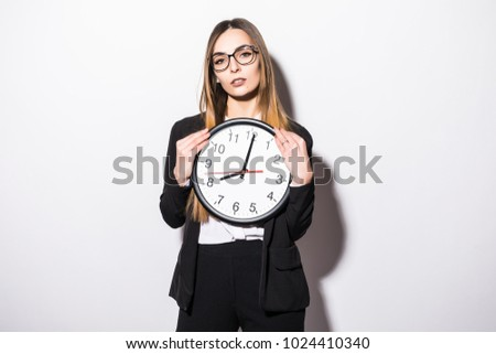 Young businesswoman holding clock with start of office work hours isolated on white