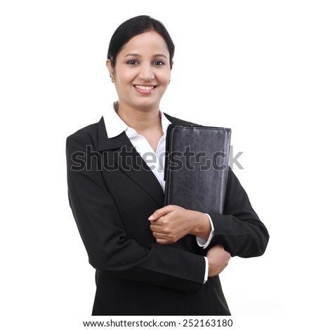 Young businesswoman holding file - stock photo