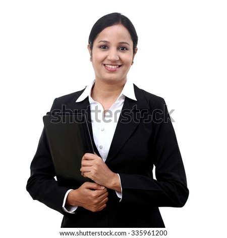 Young businesswoman holding file against white background - stock photo