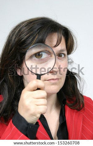 Young businesswoman holding Magnifying Glass, business photo