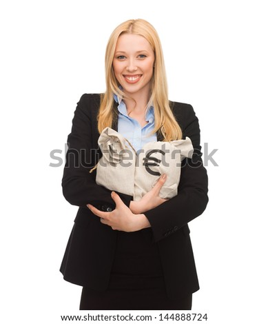 young businesswoman holding money bags with euro - stock photo