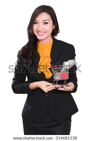 young businesswoman holding trolley and money, isolated on white background
