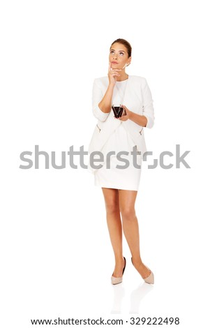 Young businesswoman holds empty wallet. - stock photo